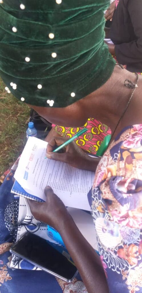 A woman is seen studying in Tanzania